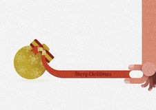 Hand catch ribbon of Christmas ornaments by Christmas concept Royalty Free Stock Image