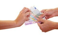 Hand catching Euro money Stock Photos