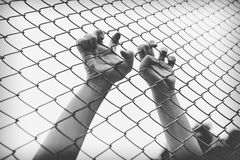 Hand catching mesh cage. The prisoner want freedom. Dramatic Blurry Hands catching mesh cage. The prisoner want freedom.Man lack of Independence Royalty Free Stock Photo