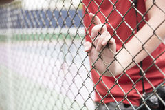 Hand catching mesh cage. The prisoner want freedom. Stock Image