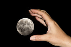 Hand catching the moon Royalty Free Stock Images