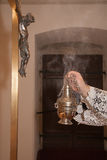Hand of catholic priest at incense Royalty Free Stock Image