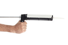 Hand with caulking gun tool isolated Stock Images