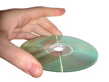 Hand and CD. Hand holding a CD-Rom on white background royalty free stock photography