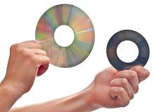 In hand cd's Royalty-vrije Stock Afbeeldingen