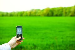 Hand and cell phone. With signal Royalty Free Stock Photos