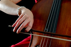 Hand on cello bow Stock Photos