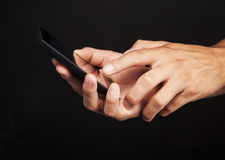Hand with cellphone Stock Images