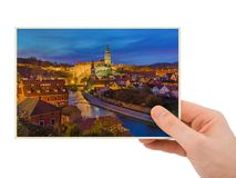 Hand and Cesky Krumlov cityscape in Czech Republic my photo. Isolated on white background Stock Photo