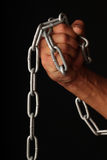 Hand and a chain. Stock Photo