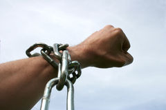 Hand in chain figthing for freedom. Hand in chain royalty free stock photos