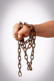 Hand with chain Stock Photography