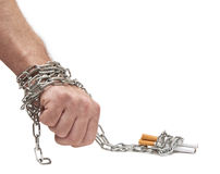 Hand chained to cigarettes on white. Hand chained to cigarettes. Slavish dependence stock photography