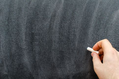 Hand with chalk Stock Image