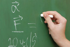 Hand with a chalk, mathematical formulas Royalty Free Stock Photos
