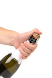Hand with champagne bottle isolated Royalty Free Stock Image