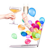 Hand with champagne and laptop Stock Images