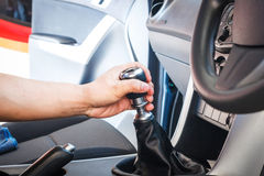 Hand changing a car transmission Royalty Free Stock Image