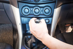 Hand changing a car transmission Stock Photos
