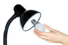 Hand changing a regular light bulb for LED Royalty Free Stock Images
