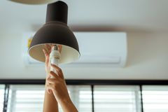 Hand Changing With New LED Lamp Light Bulb,Power Saving Concept Royalty Free Stock Images
