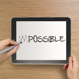 Hand changing the word impossible to possible Stock Photos