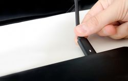 Hand charge notebook by connecting power cord.  royalty free stock image