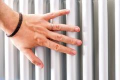 Hand check heater temperature radiator closeup Stock Images