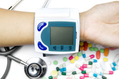 Hand checking the blood pressure Stock Photo