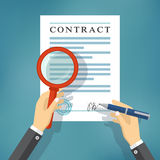 Hand checking contract with a magnifying glass. stock image