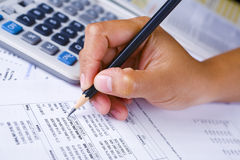Hand checking financial report Stock Photography