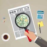 Hand checking newspaper Stock Photo