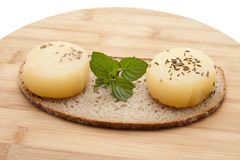 Hand cheese with mint Stock Photography