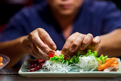 Hand of Chef Making sushi Royalty Free Stock Image