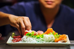 Hand of Chef Making sushi Stock Images