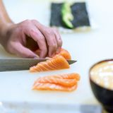Hand of Chef Making sushi Stock Photography