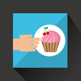 Hand with cherry fruit cupcake Royalty Free Stock Image