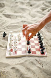 Hand with chess figure making move Stock Images