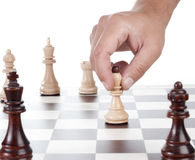 Hand chess move pawn. Chessboard and on it chessmen Stock Photos