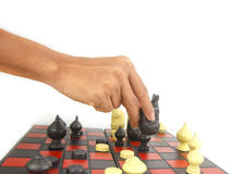 Hand with chess piece show black check and win game Royalty Free Stock Photo
