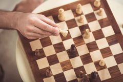 Hand of chess player making a move of check mate during game Stock Images