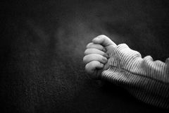 Hand child b&w. Single and lonely hand child Infant b&w Stock Photo