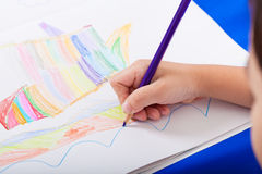 Hand of child drawing. By colour pencil royalty free stock photography
