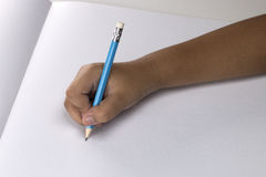Hand of a child drawing stock photos