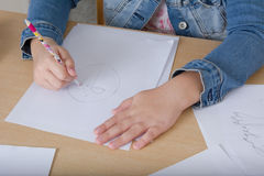 Hand of a child drawing on white paper Royalty Free Stock Images