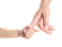 Hand of child and father Royalty Free Stock Image