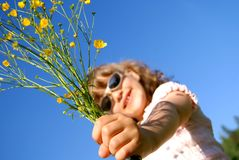 Hand of the child with flowers Royalty Free Stock Photos