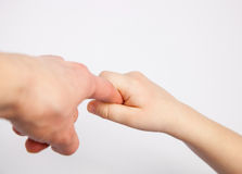 Hand of a child holding parent's finger Royalty Free Stock Images