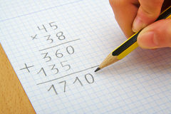 Hand of a child making a multiplication with a Royalty Free Stock Image