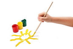 Hand of child painting sun Stock Photo